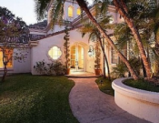 The Mediterranean estate of Ms. Sharon Stone with a wonderfully gated driveway