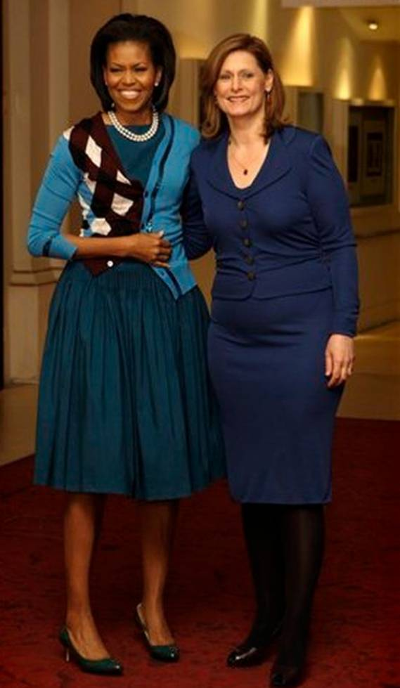 The US First Lady appeared in the knitted asymmetric cardigan at a high-profile event.