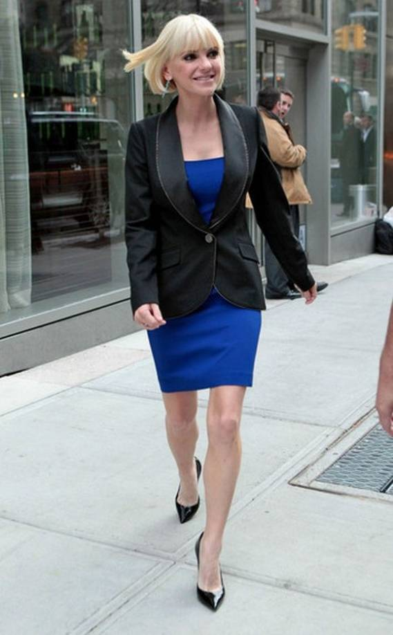 Anna Faris was spotted leaving her hotel with a jacket over her blue, scoop-neck crepe dress which has been titled as the 'bird' by designers at Juicy Coutre Clothing.