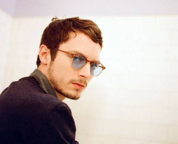 The actor wore the retro inspired frames during a photo shoot.