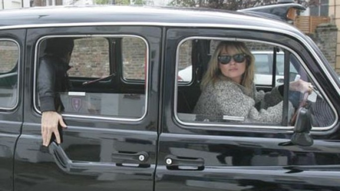 English model Kate Moss loves to drive around the streets of London in her metallic black colored Hackney Carriage.