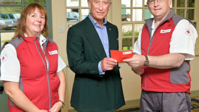 Prince Charles is presented with his first aid certificate by Red Cross