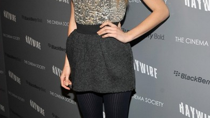 Blake Lively has been spotted wearing Dolce & Gabbana Gray Knitted Mini Skirt number of times.