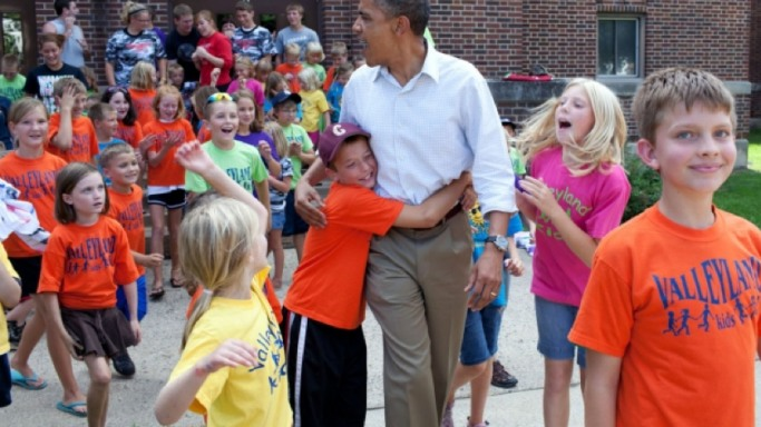 Barack Obama greets children from the Valley land Kids summer program