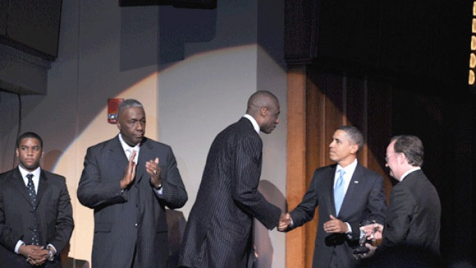 Barack Obama gives award to alumnus Dikembe Mutombo, president of the Dikembe Mutombo Foundation