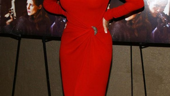 Helen Mirren looked like a luscious apple as she donned the rich crimson-red, stretch-jersey dress from Michael Kors.